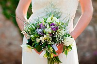 Bride holding bouquet, close up