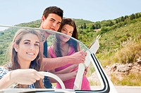 Young friends with convertible car looking at map (thumbnail)