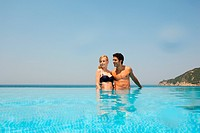 Young couple in infinity pool