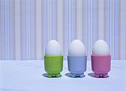 Three Eggs in Egg Cups on Table