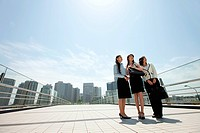Businesswomen standing in city scene