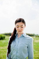 Portrait of young businesswoman with eyes closed