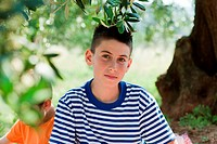 Boy wearing striped t shirt, portrait