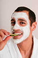 Man with Face Mask Eating Cucumber Slice