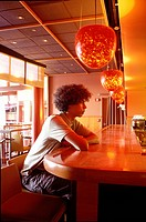 Young man sitting at bar