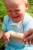 Crying baby boy outdoors