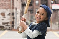 Mixed race girl playing baseball