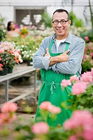 Hispanic florist working in nursery