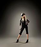 Trendy Caucasian woman standing