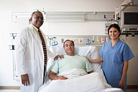 Doctor, nurse and patient in hospital room