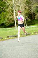 Mixed race teenager running outdoors