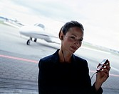 Businesswoman Using Cell Phone at Airport