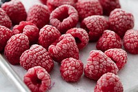 Close up of frozen red raspberries