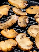 sauteed mushrooms on a grill