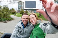 Couple Taking Self_portrait in Stanley Park, Vancouver, British Columbia.