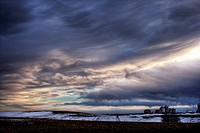 Distant Farm in Snowy Landscape at Sunset, Bon Accord, Alberta