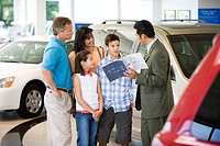 Car Salesman Speaking with Family
