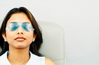 Woman with Cold Pack over Eyes