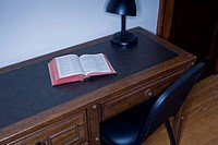 Bible on top of bedroom desk