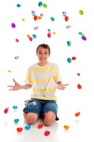 Happy boy with easter eggs falling