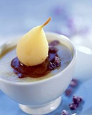 Semolina,stewed pear and chocolate sauce