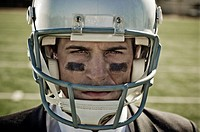 Businessman in Football Helmet