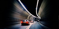 Cars Speeding Through Tunnel
