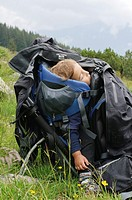 Boy of two asleep in a backpack baby carrier  Photogrpahed in the Austrian Alps