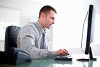 Young businessman working concentrated on his computer