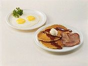 Fried Egg, pancake, and meat on plate