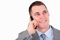 Close up of businessman looking up while on the phone on white background