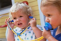 Children Playing with Toy Stethoscope