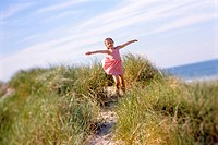 Girl Playing on Dunes