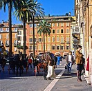 People, horse eating from feed sack and barouches, Piazza di Spagna, Rome, Italy