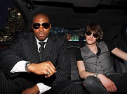 Celebrity and bodyguard in back of limo