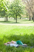 Couple laying in grass together