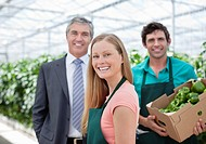 Businessman and workers in greenhouse