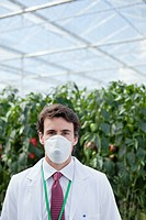 Scientist wearing mask in greenhouse