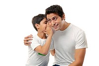 Boy whispering in his fathers ear