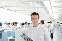Scientist using clipboard in lab