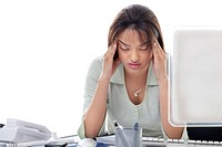 Beautiful young businesswoman with headache at office