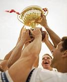Team Holding up Trophy