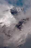 Fog Surrounds a Snowy Mountain