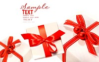 Gifts wrapped with red ribbons isolated on white