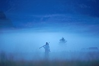 A photographer stands in morning mist at the 1996 Eco_Challenge. The Eco_Challenge is an adventure race that covers 300 miles through the mountains of...