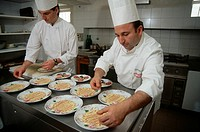 Chefs Giuseppe Palermino right and Enzo Cerelli left prepare dishes of Veal Tartare.