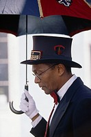 Musician MacArthur Hewitt, of the Spirit of New Orleans marching band, carries an Umbrella in New Orleans.