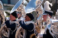 Tuba players play in a marching band for the Florida Strawberry Festival parade in Plant City, Florida.