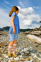 girl in blue on rocky beach