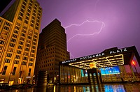 Lightning over the Bahnhof Potsdamer Platz and the Ritz-Carlton Hotel on left, Mitte, Berlin, Germany